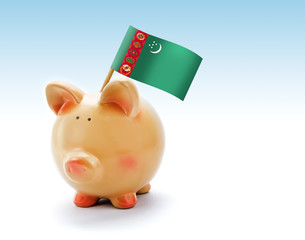 Piggy bank with national flag of Turkmenistan