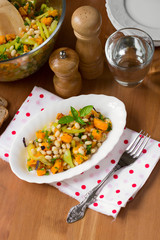 Healthy vegan salad with baked pumpkin, vegetables and beans