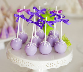 Sweet holiday buffet with cake-pops on sticks