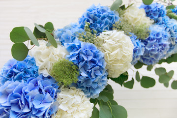 Wedding arch from white and blue flowers