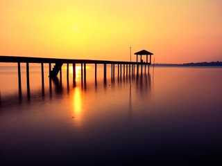 silhouette of jetty at sunrise