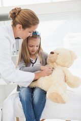 Doctor giving a patient a stuffed bear