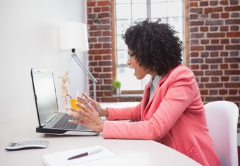 Stressed casual businesswoman sitting at desk