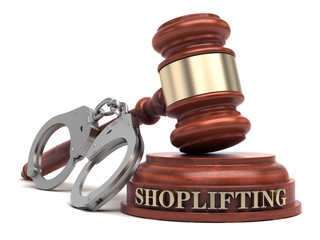 Shoplifting text on sound block & gavel