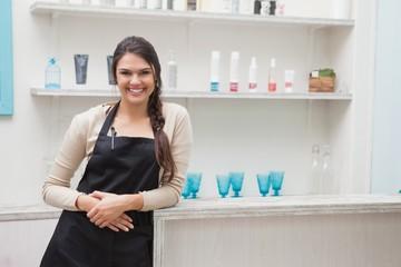 Smiling hairdresser in work stock room