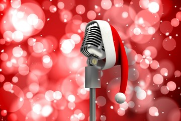 Composite image of microphone with santa hat