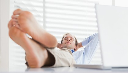 Relaxed businessman with his feet up