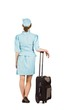 canvas print picture - Pretty air hostess leaning on suitcase