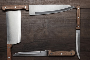 kitchen knifes on the brown wooden table