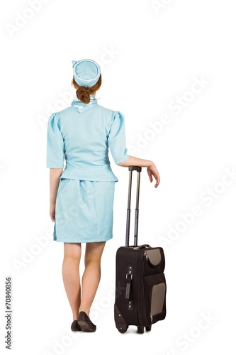 canvas print picture Pretty air hostess leaning on suitcase