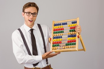 Geeky businessman using an abacus