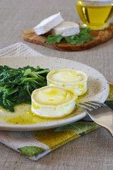 French cuisine: Warm goat cheese with greens