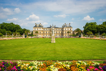 Luxembourg gardens and palace with puffy clouds in Paris