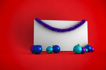 Composite image of christmas decoration and poster