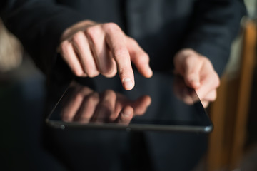man holding digital tablet, closeup