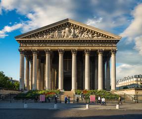 Madeleine church under dramatic sky, Paris