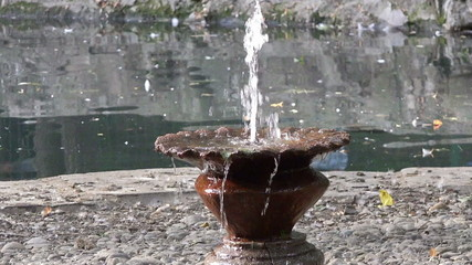 rusty water fountain in a park