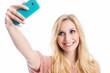 canvas print picture - Blonde Frau macht ein Selfie