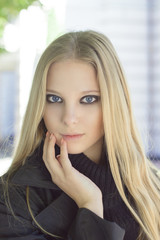 Fashion portrait of young blonde girl with smoky eyes