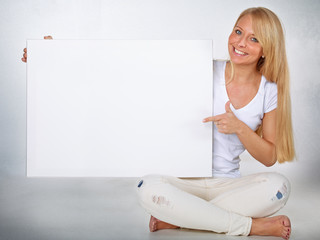 Blond woman with whiteboard