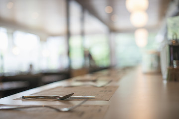 A empty table at a diner. Place settings. Surface view