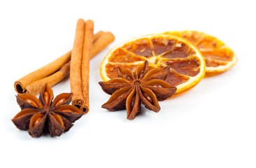 dry orange, cinnamon and Star Anise with copy space, on white ba