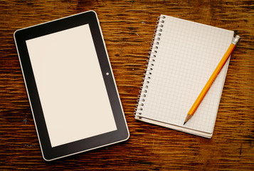 Blank notepad with a tablet computer and pencil