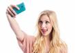 canvas print picture - Mädchen macht Selfie und streckt Zunge heraus