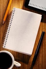 Notebook and Phone on Desk with Cup of Coffee