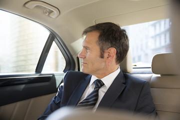 Deutschland, Berlin, Geschäftsmann im Taxi
