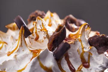 Closeup meringue cake with chocolate and caramel