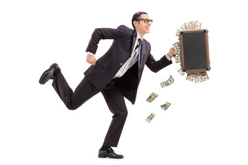 Businessman running with a bag full of money