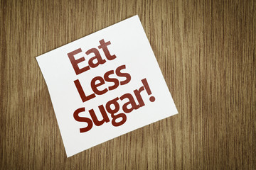 Eat Less Sugar on Paper Note with texture background
