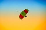 parachute against blue sky poster
