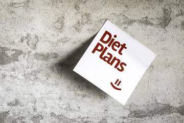 Diet Plans on Paper Note with texture background