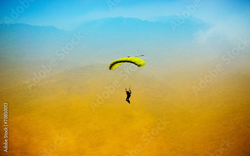 parachute against blue sky - 70850013