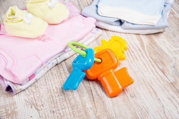 clothing and accessories for babies, toy beanbag and bottle of f