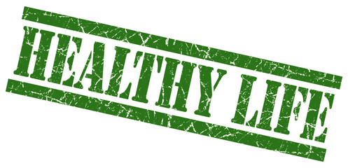 healthy life green grungy stamp on white background