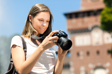 Woman taking pictures in the city