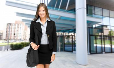 Businesswoman walking outdoor