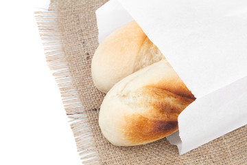 Bread packaged in a paper bag isolated on the white
