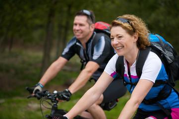 Cheerful couple enjoying a bike ride in nature