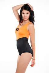attractive brunette slim girl in swimsuit