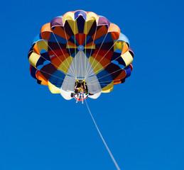 Parasailing over the blue sky