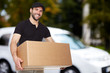Leinwanddruck Bild - Smiling delivery man