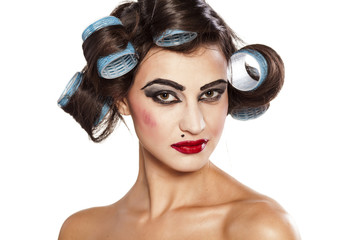 Funny woman with curlers and bad makeup
