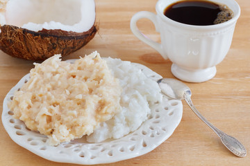 Coconut candy cocada on plate with cup of coffee and coconut