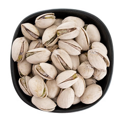 Pistachio nuts in bow, isolated.  Pistacia vera.