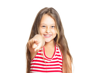 laughing little girl points to a forefinger
