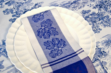 blue and white cloth napkin on dinner plate